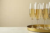 Tray with glasses of champagne, space for text