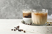 Composition with tray with ice coffee on wooden background
