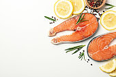 Composition with salmon meat and spices on white background, top view