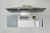 Concept of workplace with desktop computer on gray table