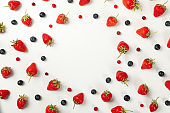 Flat lay with tasty strawberry and blueberry on white background, top view. Summer berry