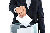 Man putting ballot into voting box, isolated on white background