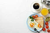 Delicious breakfast or lunch with fried eggs on white background, space for text