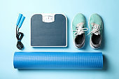 Weight loss or healthy lifestyle accessories on blue background