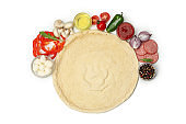Dough and ingredients for cooking pizza isolated on white background