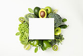 Fresh green vegetables and space for text on white background