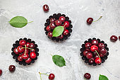 Fresh cherries on marble background