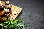 Rosemary essential oil on black background