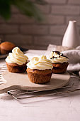 Chocolate muffins with cheese cream