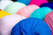 Bright multi-colored acrylic yarn. Colorful background.
