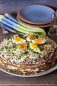 Layered liver cake with cheese, mayonnaise and dill