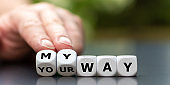 """Hand turns dice and changes the expression """"your way"""" to """"my way""""."""