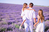 Family of three in lavender flowers field