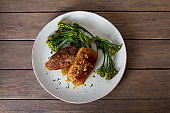 Duck breast fillets with caramelized onion and broccoli