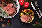 Roasted beef. Christmas decorations. New Year dinner table