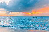 Idyllic tropical beach in Caribbean with white sand, turquoise ocean water and blue sky