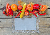 Autumn background set, fallen leaves, fruits, vegetables, wooden table.