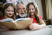 Best family activity is reading stock photo