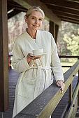 Joyful mature woman enjoying morning in countryside