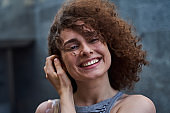 Cheerful pretty young woman in open air