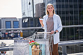 Happy woman with bank card after shopping