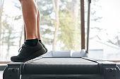 Leg, calf muscles workout on treadmill at health club