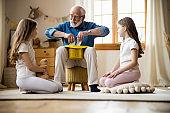 Kids waiting for magic trick from grandpa stock photo