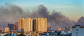 Dramatic scenery of buildings with smoke for city pollution concept