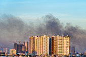 Scenery of polluted city with dark smoke from factory chimneys