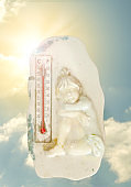 Hot summer or heat wave,sky with with bright sun and thermometer,heat,global warming concept