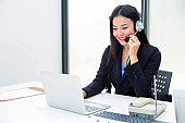 Asian call center staff. Call to talk to customers with friendly service and beautiful talk. Smile with friendly service.