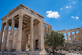 Athens, Greece. Erechtheion with Caryatid Porch on Acropolis hill, blue sky background
