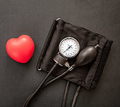Medical sphygmomanometer on black background, closeup view.