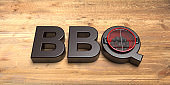 BBQ text against wooden background. 3d illustration