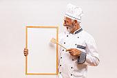 Senior chef showing whiteboard