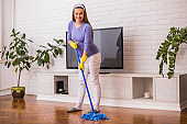 Pregnant woman cleaning house
