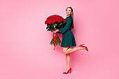 Full length photo of attractive charming lady model hold large one hundred roses bunch satisfied best boyfriend wear green vogue dress high-heels isolated pastel pink color background