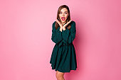Photo of charming crazy chic lady cheerful good mood got prom invitation excited hold arms near cheeks wear short green elegant dress isolated pastel pink color background
