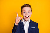 Close-up portrait of his he handsome intellectual cheerful cheery pre-teen boy find creating solution pointing up great idea isolated bright vivid shine vibrant yellow color background