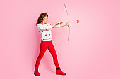 Full length body size profile side view of her she nice attractive lovely cheerful cheery confident wavy-haired girl angel shooting arrow dream first date isolated on pink pastel color background