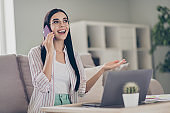 Photo of young business woman hold telephone talk explain wear spectacles shirt in home workstation indoors
