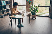 Full size photo of cool smart afro american girl real estate agent work computer type start-up presentation sit table in office loft