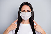 Portrait of confident girl medicine worker promoter show medical mask point index finger approve safety corona virus quality prevention wear stylish outfit isolated gray color background