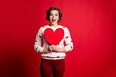 Omg its for me. Portrait of crazy cheerful positive girl hold big paper card heart she get on 14-february celebration wear pants trendy trousers isolated over vivid color background