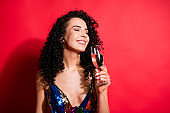 Close-up portrait of gorgeous cheerful dreamy wavy-haired girl drinking wine enjoying rest isolated on bright red color background