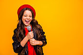 Close-up portrait of her she nice-looking attractive charming trendy fashionable cheerful wavy-haired girl singing karaoke hit isolated over bright vivid shine vibrant yellow color background