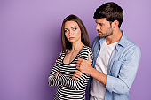 Profile photo of two people couple guy asking offended lady forgiveness feel sorry holding her shoulders wear stylish casual outfit isolated pastel purple color background