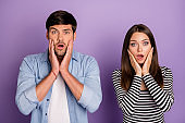 Photo of two people couple holding arms on cheeks listen negative awful terrible news wear stylish casual outfit isolated pastel purple color background