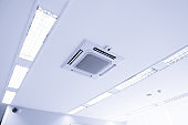 White ceiling mounted cassette type air conditioner for large rooms, exhibition room