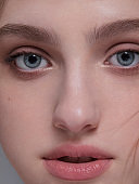 Dreamlike woman face Natural beauty with blue eyes perfect skin Fashion model close-up portrait